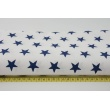 Cotton fabric in a pattern of navy stars 25mm on a white background