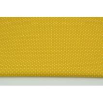 Cotton 100% mini dots on a mustard background, poplin
