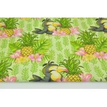 Bawełna 100% tukany i ananasy na zielonym tle