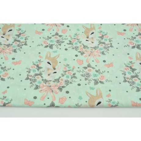 Cotton 100% deers in a rose ornament on a mint background