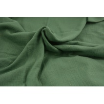 Double gauze 100% cotton gold dust on a green background