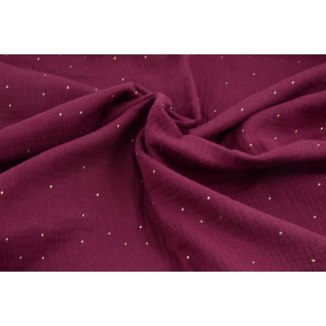Double gauze 100% cotton gold dust on a burgundy background