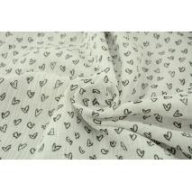 Double gauze 100% cotton black hearts on a white background