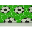 Cotton 100% footballs on a green background