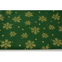 Cotton 100% glitter snowflakes on a green background