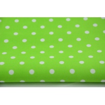 Cotton 100% white 7mm polka dots on a bright green background