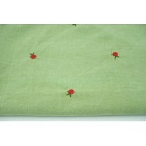 Cotton 100% embroidered roses on a green background