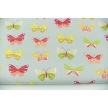 Cotton 100% colorful butterflies on a gray background, poplin