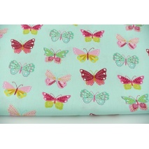 Bawełna 100% kolorowe motylki na miętowym tle, popelina