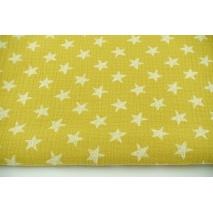 Muślin bawełniany, rysowane gwiazdki na musztardowym tle