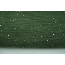 Double gauze 100% cotton golden confetti on a rotten green background