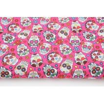 Cotton 100% colored skulls on a amaranth background, poplin