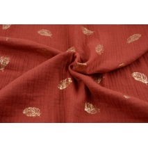 Double gauze 100% cotton golden feathers on a brick background