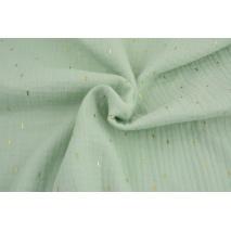 Double gauze 100% cotton golden marks on a mint background