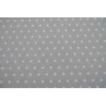 Bawełna gwiazdki białe 2cm na jasnobeżowym tle II jakość