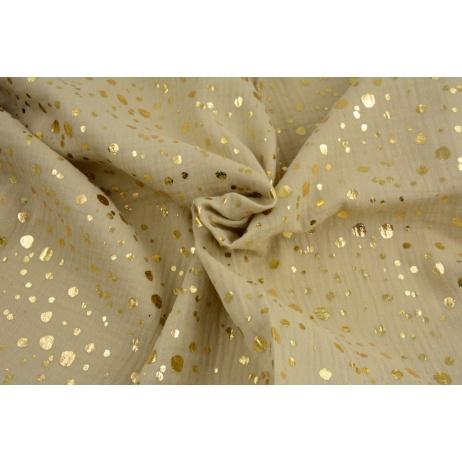 Double gauze 100% cotton golden spots on a sand background