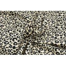 Single jersey, leopard print on sand background