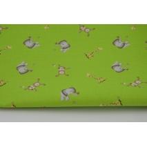 Bawełna 100%, słoniki, małpki i żyrafy na zielonym tle