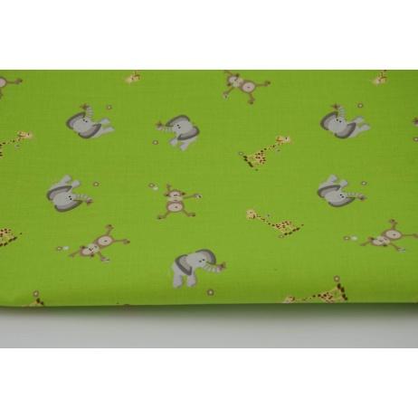 Bawełna 100% słoniki, małpki i żyrafy na zielonym tle