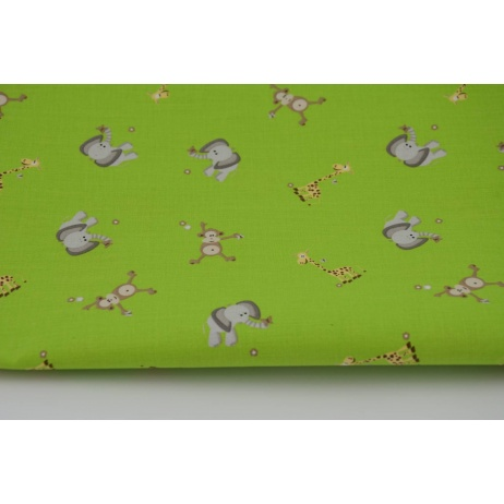 Cotton 100% elephants, monkeys and giraffes on a green background
