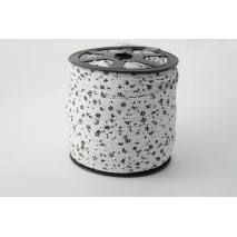 Cotton bias binding black meadow on a white background