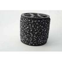 Cotton bias binding meadow on a black background