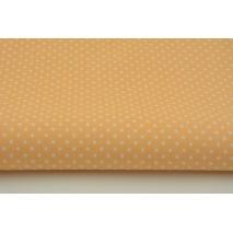 Bawełna 100% kropki białe 2mm na brzoskwiniowym tle
