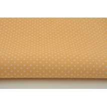 Cotton 100% white 2mm polka dots on a peach color background