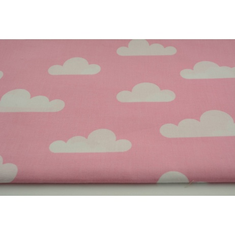 Cotton 100% white clouds on a pink background