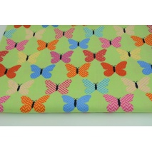 Cotton 100% colorful butterflies in dots, stripes, check on a green background