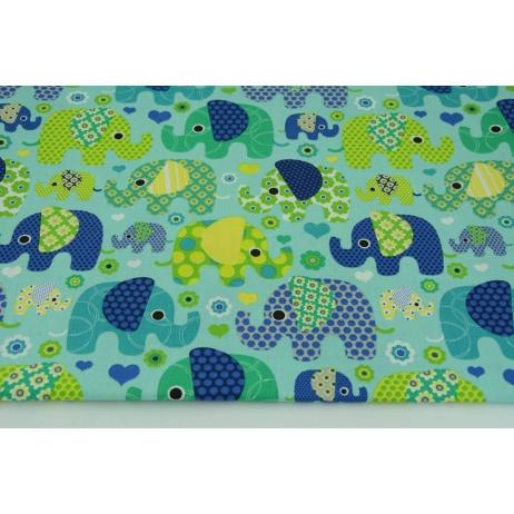 Bawełna 100% kolorowe słoniki na miętowo-trukusowym tle