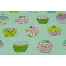 Cotton 100% cupcakes on a mint background