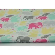 Bawełna 100% różowo-żółto-szaro-miętowe słonie na białym tle