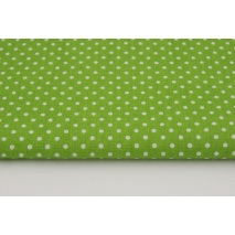 Cotton 100% white 2mm polka dots on a green background