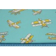Cotton 100% mustard planes on a subdued, turquoise background